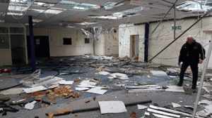 The damage caused by travellers inside a building